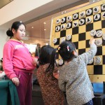 Children exploring the chess board