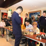 Young player against GM Yu Yangyi during a simul match 2015