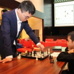 GM Yu Yangyi against young chess player